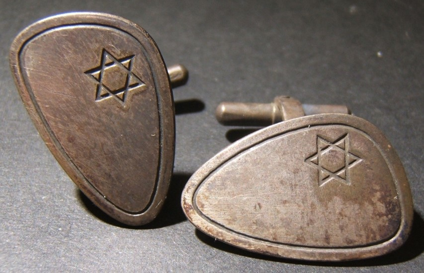Israel: patriotic silver cufflinks, 1950's; oblong shaped with incuse borders and a Star of David; one marked