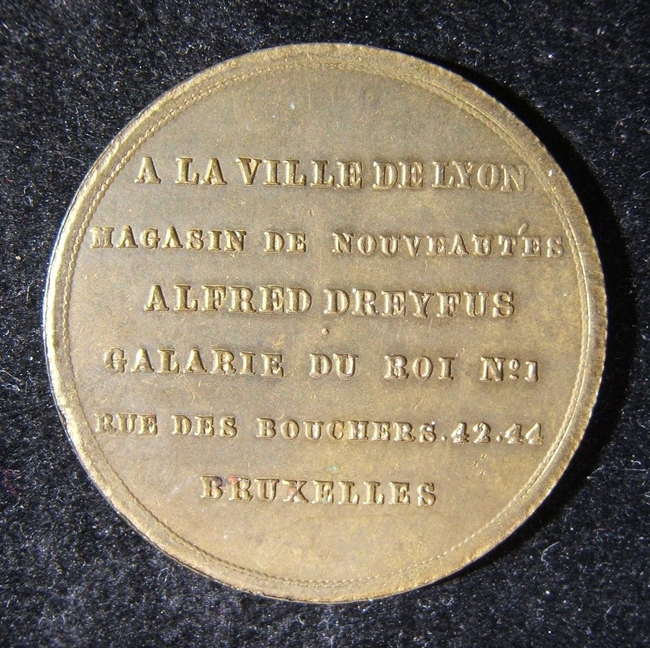 France: Alfred Dreyfus of Lyon drapery business token, c. 1880s-90s; not maker-marked; size: 32mm; weight: 8.8g. Obv.: 6 lined French legend