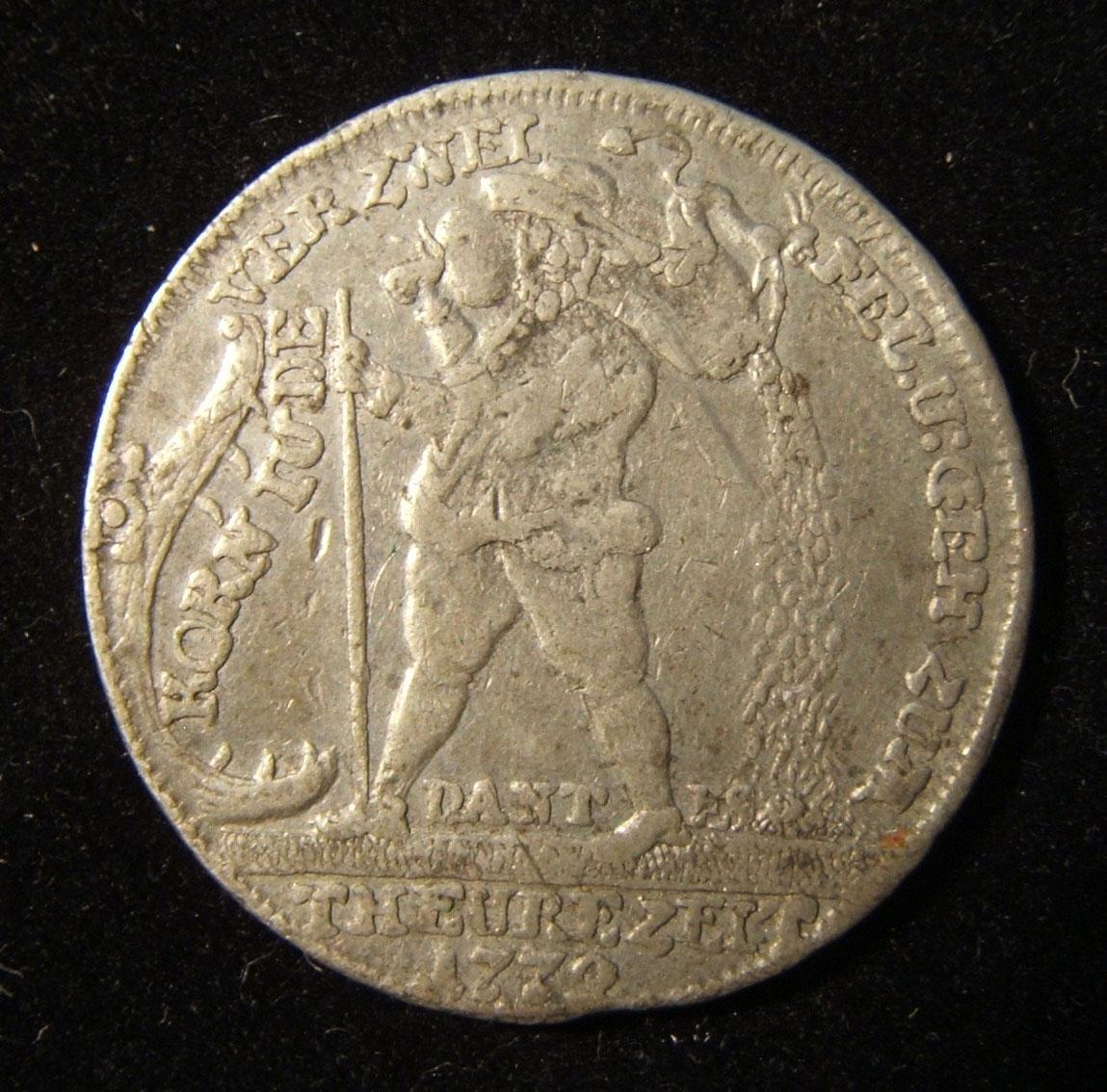 Germany > Bavaria > Fürth: Kornjude jeton, 1772, by Johann Christian Reich; struck in pewter(?); size: 29mm; weight: 6.75g. Obv.: Jewish grain peddler to left w/ Devil on sac