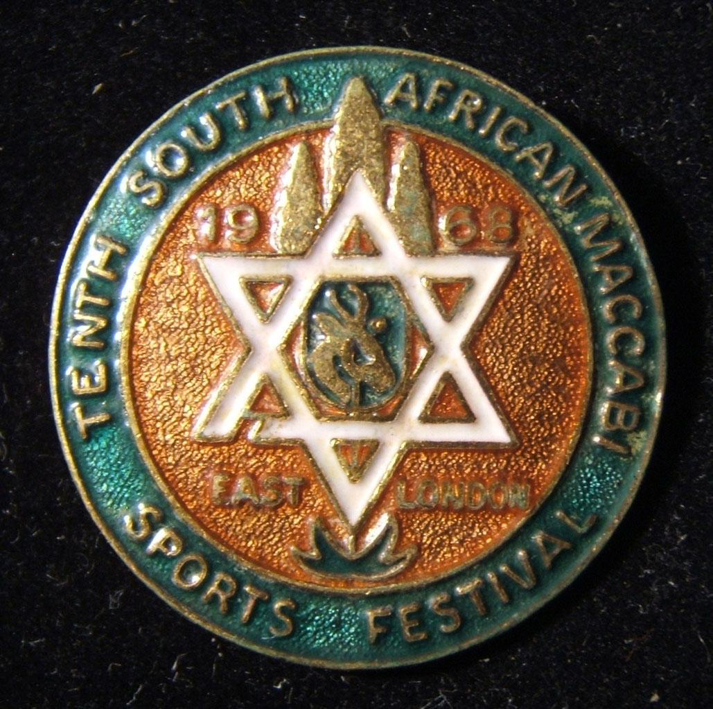South Africa: 10th South African Maccabi Sports Festival at East London 1968 gilt and color enamel pin with safety-pin reverse, made by McCallum of Capetown; size: 29mm; weight: 8.