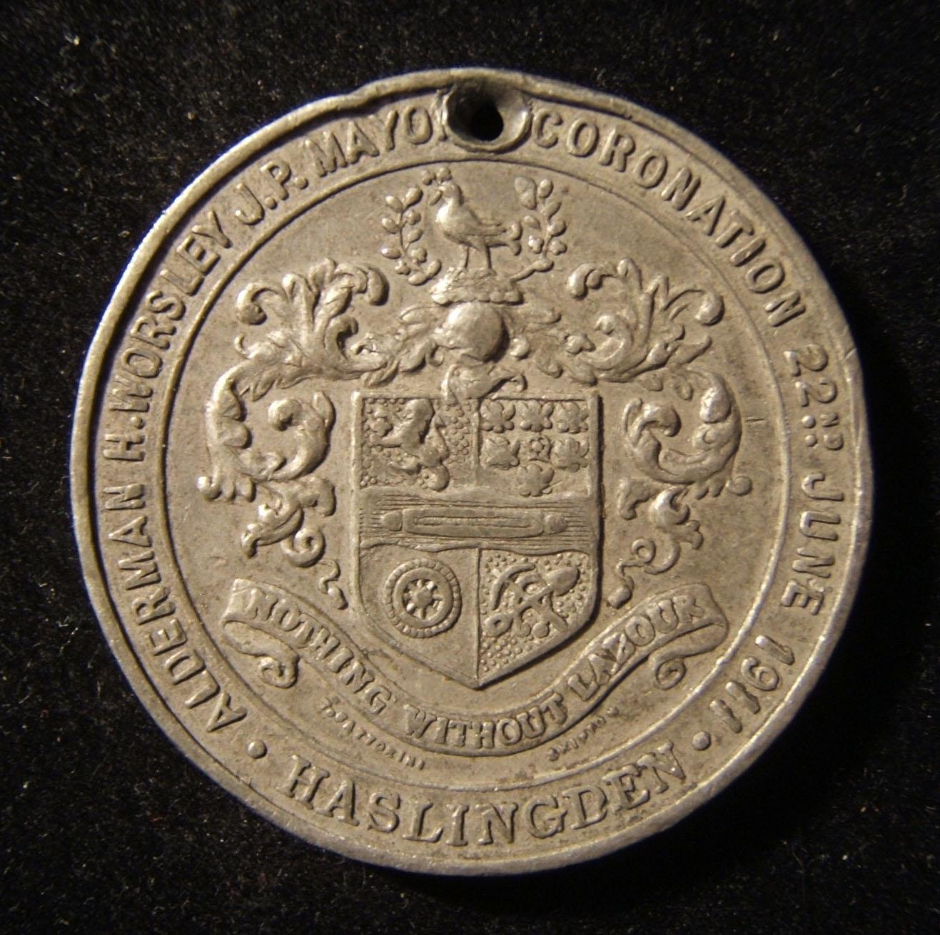 Great Britain / Haslingden city King George V coronation medallion, 1911; struck in aluminum; by T. Sattorini and Skipton; weight: 16.85g; size: 38.5mm. Obverse depicts the town ar