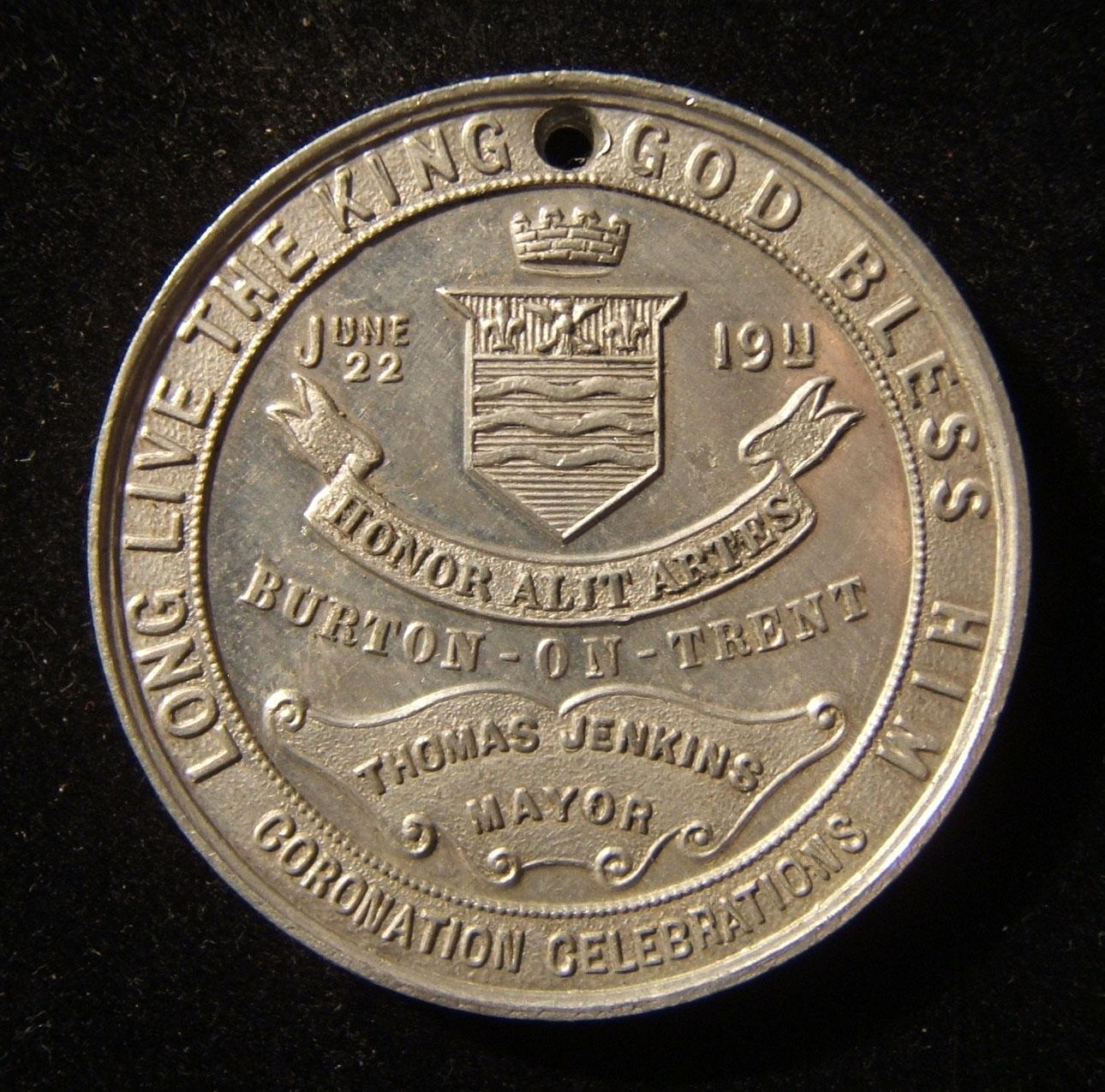 Great Britain / Burton-on-Trent King George V coronation medallion, 1911; struck in tin; no makers mark; weight: 7.9g; size: 38.25mm. Obverse depicts the town arms; on reverse cojo