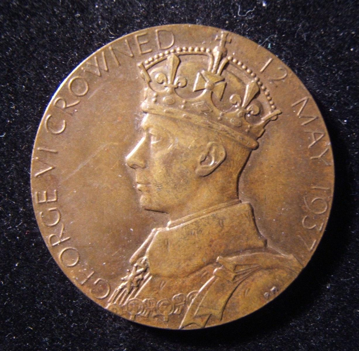 Great Britain, Coronation of King George VI coin, 1937; struck in bronze; by Percy Metcalfe; weight: 15.7g; size: 31.75mm. Obverse depicts George VI facing left; reverse depicts Qu