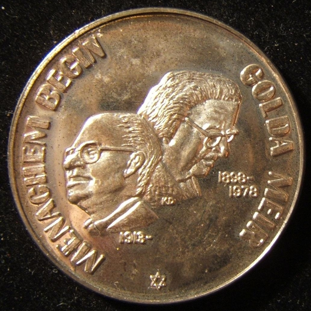US: Israeli Prime Ministers Menachem Begin/Golda Meir troy ounce silver medal, circa. 1978-79; artist marked KD; size: 39mm; weight: 31g. Obv.: busts of both PM's with dates of bir