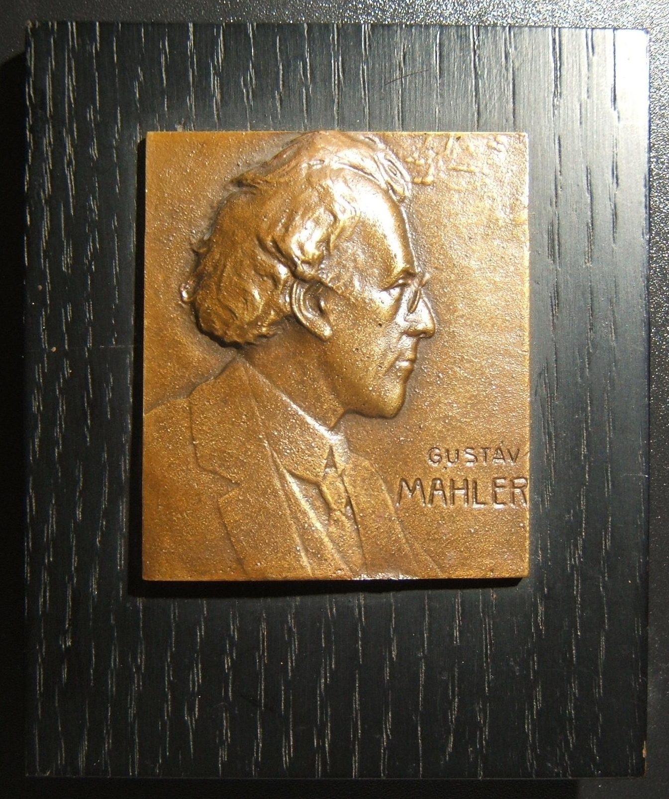 Austria: Gustav Mahler cast bronze plaque by Franz Stiasny, ND (circa. 1930's), mounted on wooden display; size (plaque only): 54.5 x 63mm; weight (whole unit) 173.3g. Right-facing
