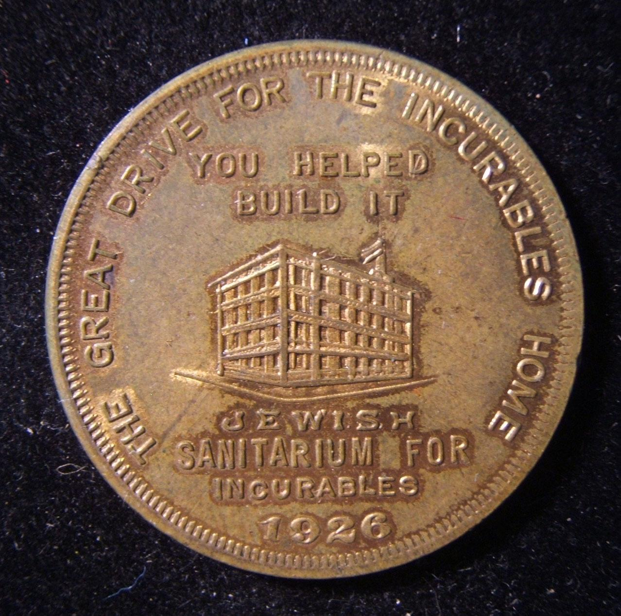 US > New York: $1 donation token for Jewish Sanitarium for Incurables, 1926; size: 33mm; weight: 10.1g. Obverse depicts image of the structure with legend