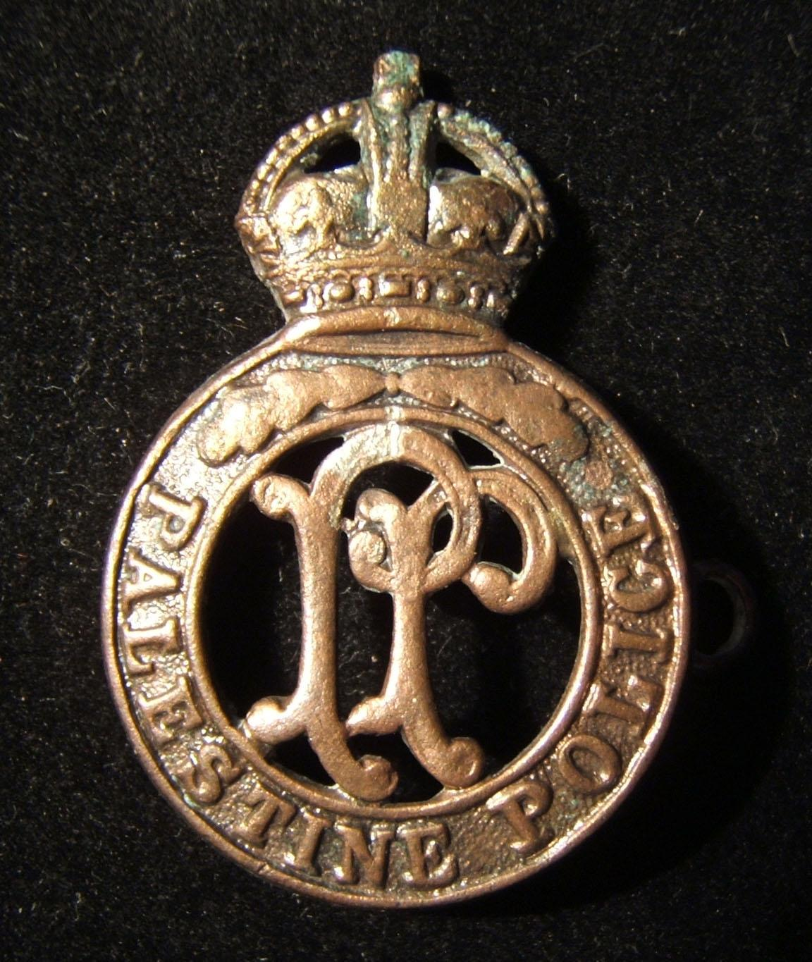 Rare Palestine Police Force copper cap badge with 2-pronged back (one missing); size: 29.5 x 43.5mm; weight: 6.8g. Maker marked