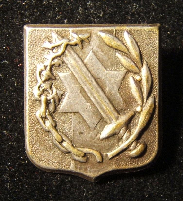 Israel: emblem pin for Palestinian Jews who volunteered in British military in World War II, c. 1954; not maker-marked; size: 17.5 x 20mm; weight: 2.5g. Depicts sword (whose base t