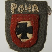 Russia: rare [hand-made] armshield badge for enlisted personnel (red border) of the 'Kaminski Brigade', with base cut from Soviet uniform. The unit evolved from a small militia in