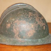 Italian M-15 steel helmet shell, in dark green paint; circa. 1921-33