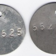 Pair of round IDF 6-digit dog tags, 1958-60