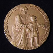 Germany > Berlin: cast bronze Work Creation Charity of the Berlin Jewish Community medal, 1935-36; not maker-marked; 60mm, 78.95g. Obv.: mother helping child; Ger. leg.