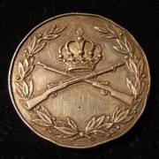 Jordan: silver military decoration, 1956; size: 29mm, thickness: 2.5mm, weight: 11.7g. Obv.: Jordanian royal crown above crossed rifles surrounded by wreath. Rev.: Arabic leg.