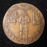 Netherlands > Dordrecht: religious jeton w/ Hebrew writing, 1608; copper; size: 29mm; weight: 5.75g. Obv.: soldier looking up in prayer between two arms - one extending a flower