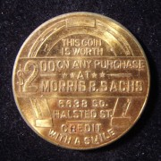 US: Morris B. Sachs clothing store $2 token w/horseshoe device