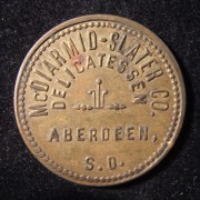 US: McDiarmid-Slater company (S.Dakota) delicatessen 50 cent brass(?) token