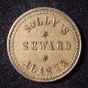 US: 'Rain check' brass token from Solly's Seward Alaska