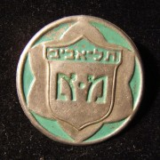 Palestine/Yishuv: first version light-green emblem pin of the Tel Aviv 'Mishmar Ezrachi' ('Civil Guard') circa. 1938-early 1940s; not maker-marked; weight: 2.1g. The design is a st