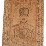 Turkey(?): Mustafa Kemal [Atatürk] carpet, circa. 1920-1923; size: carpet only (not fringes): 59.7cm x 95.7cm. Based on 1918 photo of Ataturk, although carpet's rendition more yout