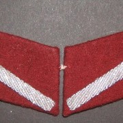Latvia: interwar Latvian Army/ WWII collaborationist [Security] Police private's collar patches, c. 1931+. Wine-colored pair w/diagonal silver tresse stripe of type used from 1931