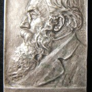 Palestine/Yishuv: [Rabbi] Dr. Gotthard Deutsch silvered bronze plaquette by Bezalel, maker-marked; size: 46 x 69.5mm; weight: 85.9g. Uniface plaquette depicting left-facing bust of