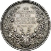 Austria > Vienna: Adolf Ignatz & Julie Marceline Mautner-Markhof Golden Wedding silver medal, 1881; by Anton Schraff; size: 39mm. Conjoined busts right within legend/Legend in wrea