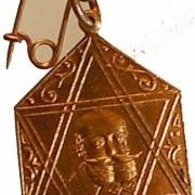 Great Britain/Palestine: Max Nordau 70th anniversary / JNF medallic pin or medalet; not maker-marked; size: 29x21mm. Obv.: large Star of David w/Nordau to right in center & Hebrew