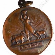 Italy/Switzerland: Keren Kayemeth (JNF) tallion, c. early 20th century; by Jewish medallist Enrico Glicenstein; size: 27.5mm. Woman in field with sheep,